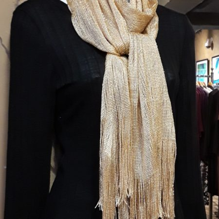 We keep these beautiful scarves in stock during the Christmas season! They have become a customer favorite!