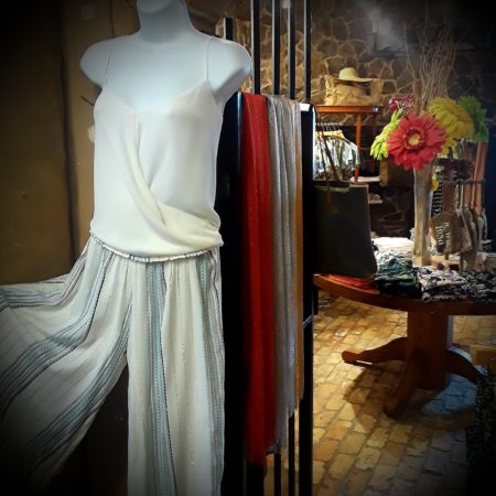 Fun and flowing wide leg pants just in time for the warm weather. Ribboned with turquoise and gold threads.