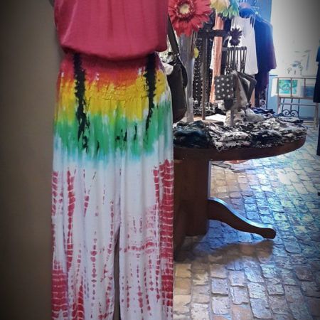 We love this fun pink halter paired with colorful genie pant